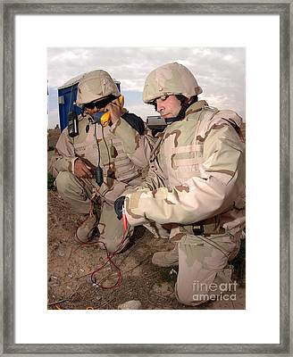 Specialists Testing Cutfield Wires Framed Print by Stocktrek Images