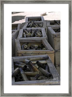 Spent .50-caliber Machine Gun Shell Framed Print by Stocktrek Images