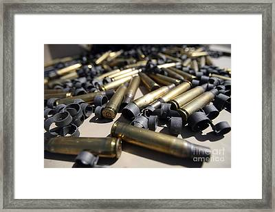 Spent Brass And Disintegrated Links Framed Print by Stocktrek Images