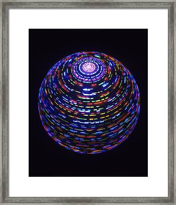 Spinning Globe Framed Print by Lawrence Lawry
