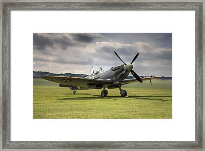 Spitfire Ready To Go Framed Print by Ian Merton