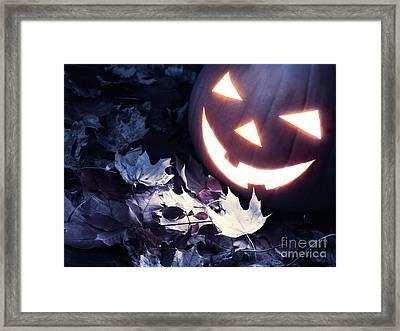 Spooky Jack-o-lantern On Fallen Leaves Framed Print