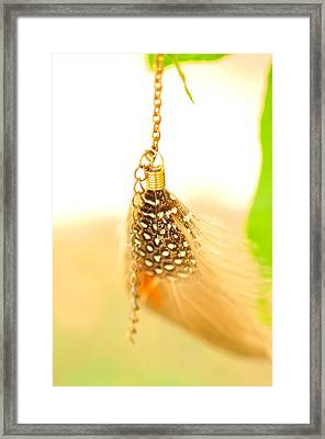 Spotted Brown Feathers In The Wind  Framed Print by Puzzles Shum