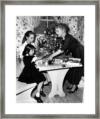 Spring Byington Helps Grandaughters Framed Print by Everett
