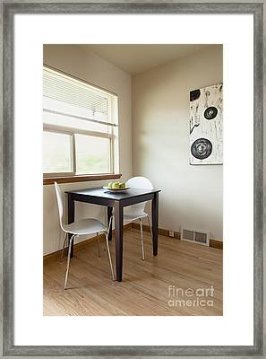 Square Table In A Sparse Room Framed Print by Inti St. Clair