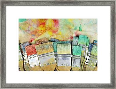 Stack Of Colorfull Paintbrushes On Palette Framed Print by Sami Sarkis
