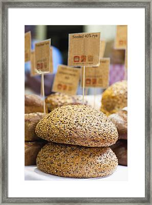 Stacks Of Fresh Bread For Sale Framed Print by Hybrid Images