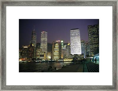 Star Ferry Terminal And Hong Kong Framed Print by Justin Guariglia