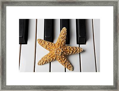 Starfish Piano Framed Print by Garry Gay