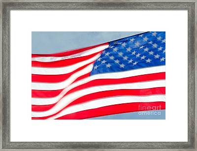 Stars And Stripes Waving Usa Flag In A Strong Wind Framed Print