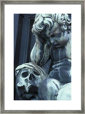 Statue Of A Child Angel Contemplating Framed Print by Stephen Sharnoff