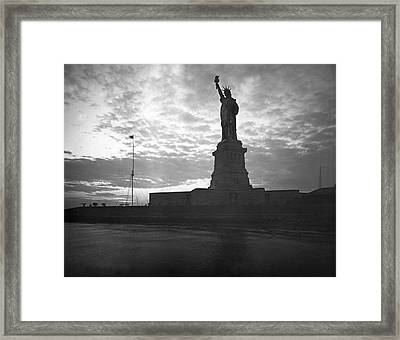 Statue Of Liberty At Sunset Framed Print by Underwood Archives
