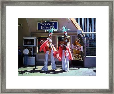 Stilt Dancers Framed Print by Steamy Raimon