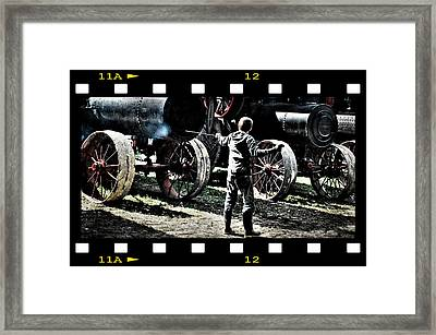 Stoking The Fire Framed Print by Janice Adomeit
