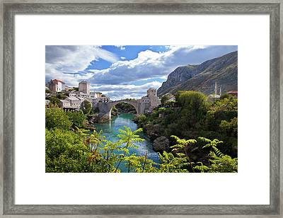Stone Bridge At Mostar Framed Print by Maurice Ford