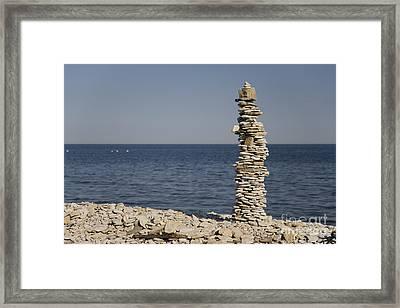 Stone Tower On The Beach Framed Print