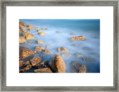 Stones In Sea Framed Print by Michele Berti