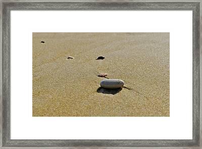 Stones In The Sand Framed Print