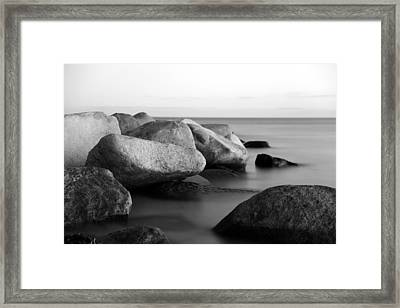 Stones In The Sea Framed Print