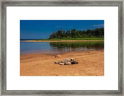 Stones On The Beach Framed Print by Doug Long