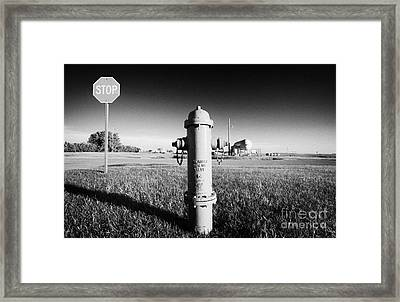 Stop Sign Against Blue Sky And Red Darling Valve Fire Hydrant In Rural Michigan North Dakota Usa Framed Print