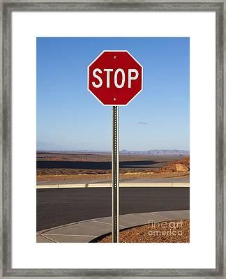 Stop Sign In The Desert Framed Print by Paul Edmondson