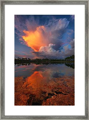 Storm Clouds At Dawn Framed Print by Claudia Domenig