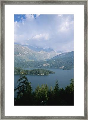 Storm Clouds Gather Over Lake Segl Framed Print by Taylor S. Kennedy