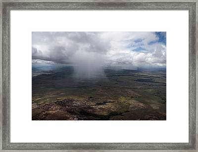 Storm Clouds Hover Above The Highlands Framed Print by Bobby Haas