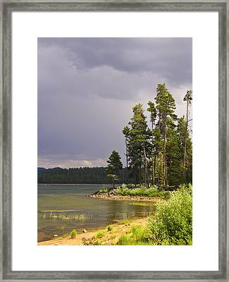 Storm Clouds Over A Lake Framed Print by Anne Mott