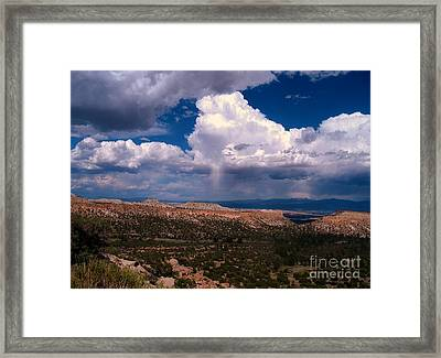 Storm Clouds Over Bandalier National Monument Framed Print by Donna Parlow