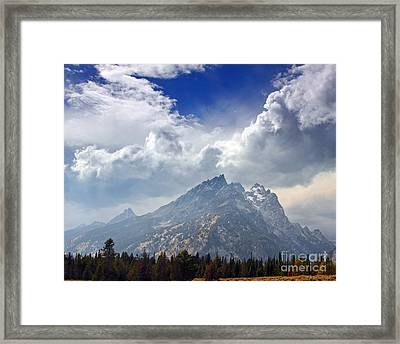 Storm Clouds Over The Grand Tetons Framed Print