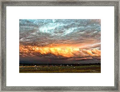 Storm Glow Framed Print by Christopher Holmes
