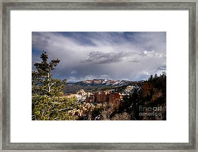 Storm Over The South Rim Bryce Canyon Framed Print by Butch Lombardi