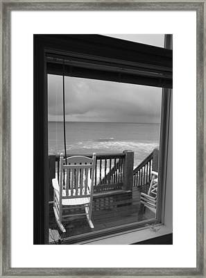 Storm-rocked Beach Chairs Framed Print