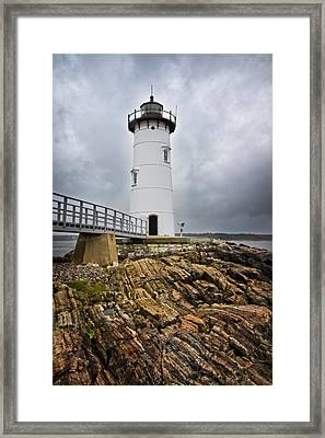 Stormy Lighthouse Framed Print by Robert Clifford