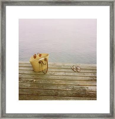 Straw Basket And Sandals On Wooden Lake Dock Framed Print by Brooke Schmidt