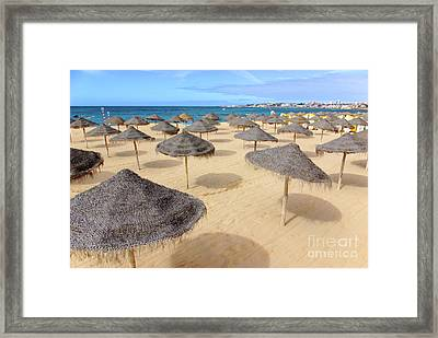 Straw Sunshades Framed Print by Carlos Caetano