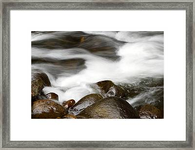 Stream Flowing Over Rocks Framed Print by Les Cunliffe