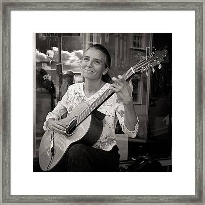 Street Guitarist Framed Print by Dale Davis