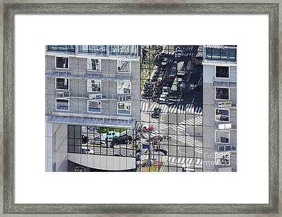 Street Seen Reflected Off A Building Surface Framed Print by Jeremy Woodhouse