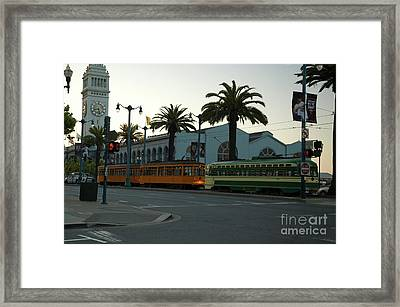 Streetcars At Sunset Framed Print by Tim Mulina