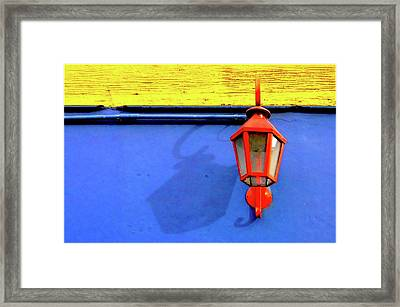 Streetlamp With Primary Colors Framed Print by by Felicitas Molina