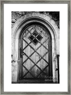 Strong Wooden Metal Braced Fortified Door For Strength In Wawel Castle Krakow Framed Print by Joe Fox