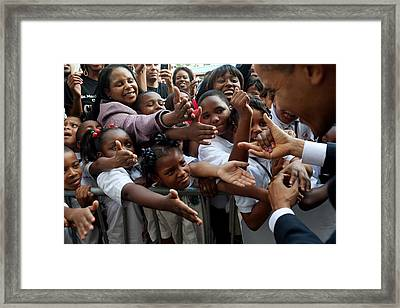 Students Hold Out Their Hands To Greet Framed Print