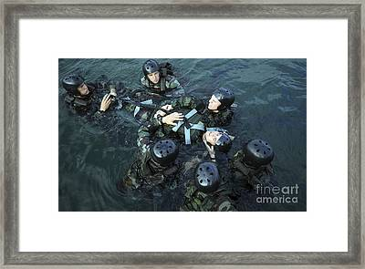 Students Secure A Simulated Casualty Framed Print by Stocktrek Images