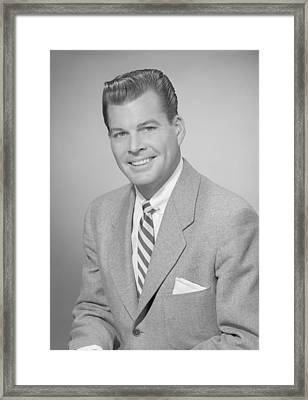 Studio Portrait Of Mid Adult Man Smiling Framed Print by George Marks