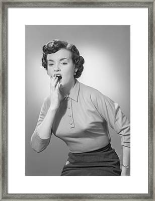 Studio Portrait Of Woman Yawning Framed Print by George Marks