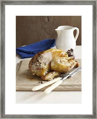 Stuffed Roast Guinea Fowl On Board Framed Print by Cultura/BRETT STEVENS