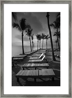 Sun Bathing Benches At A Resort On Key Islamorada Framed Print by Randall Nyhof